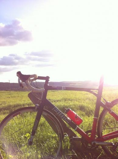 Picture of Guillaume's BMC road bike in beautiful countryside