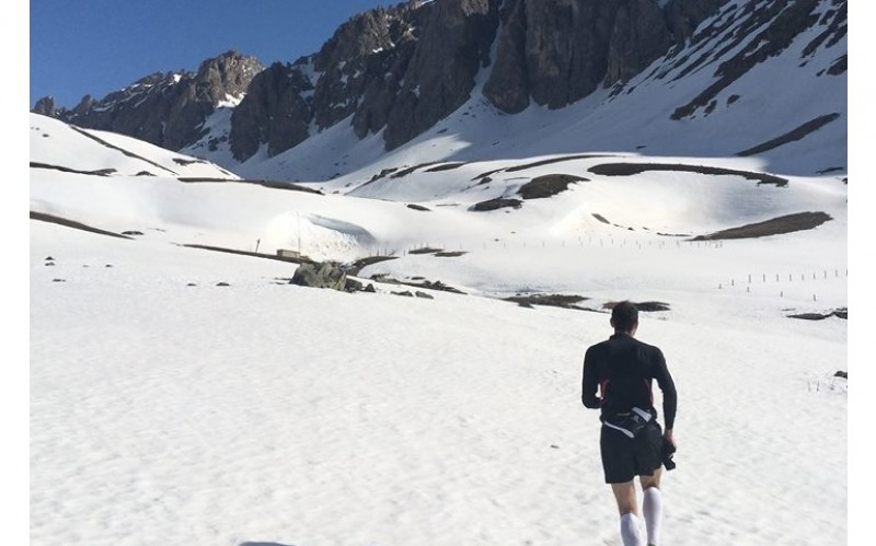 image of Guillaume running in mountains