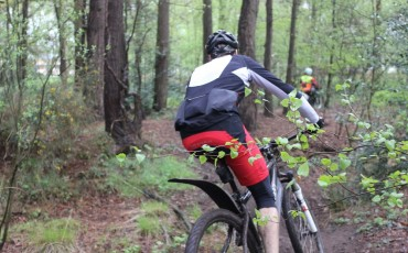 image of Del riding his bike in woods